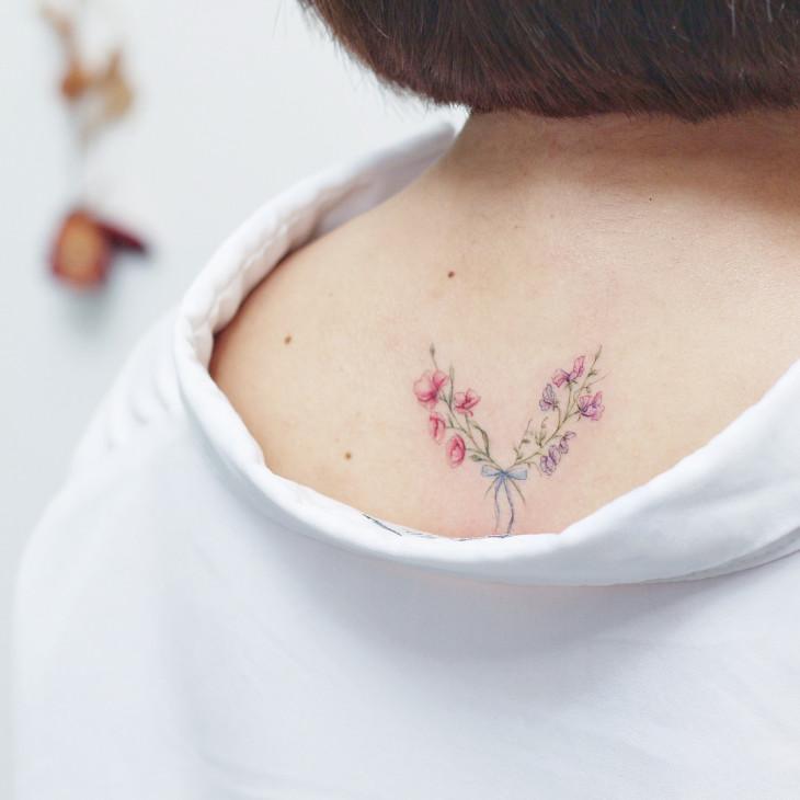 Мини Лау татуировка