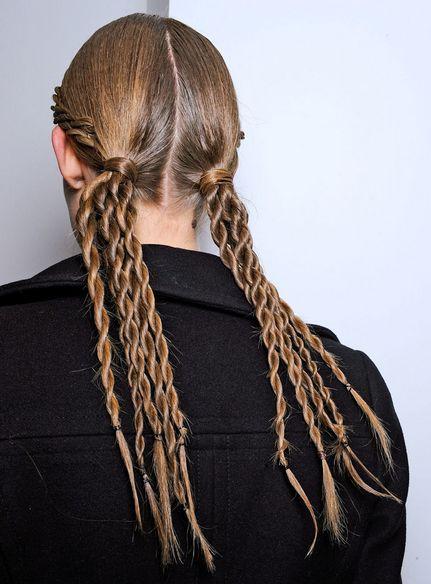 Прическа со скрученными косами