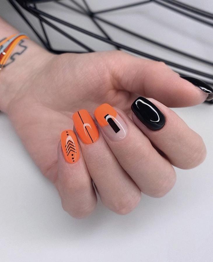 Маникюр оранжевый с черным